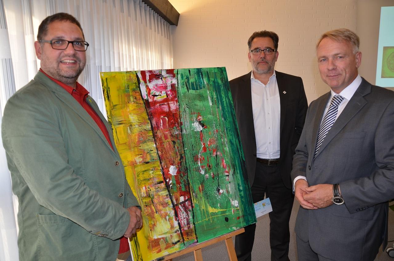 V.r.n.l. Jörg Waskönig, Geschäftsführender Vorstand AGV, Gerhard Wessels, Vorstand Gemeinnützige Werkstätten, ich.